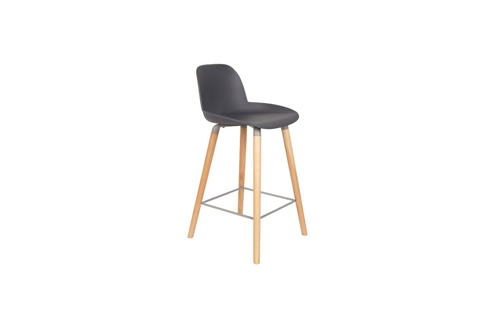 Its four slightly sloping legs are made of solid ash wood while the frame and footrests are made of