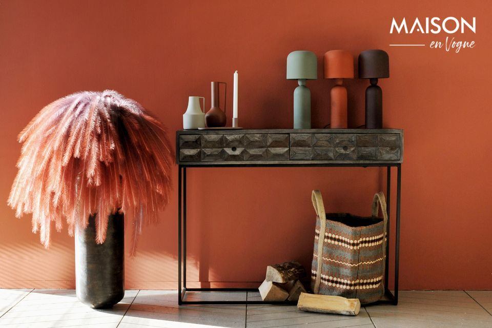 A table lamp with pure forms, in a terracotta colour