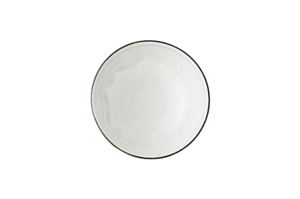 Its handcrafted porcelain manufacture means that the colour of each piece varies slightly