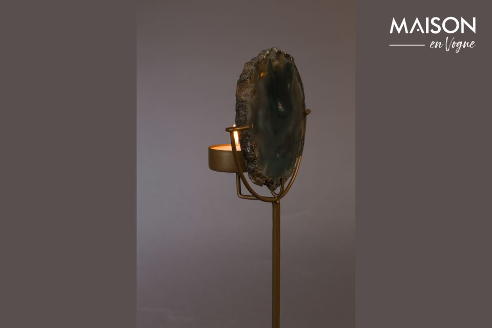 A brass lacquered iron base supports this practical and natural object