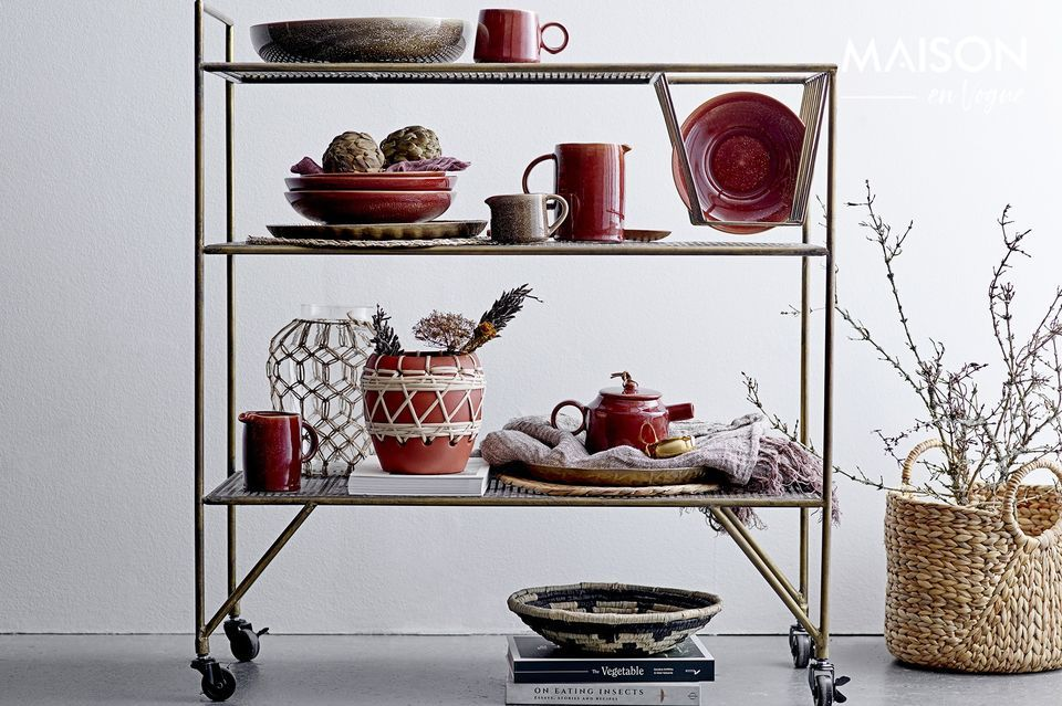 An elegant golden tray with oriental influences