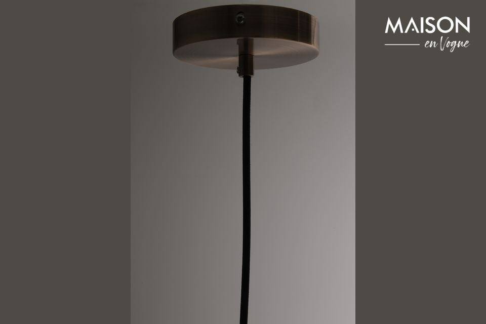 Cooper diffuses a soft light, while the bulb it conceals hardly appears by transparency