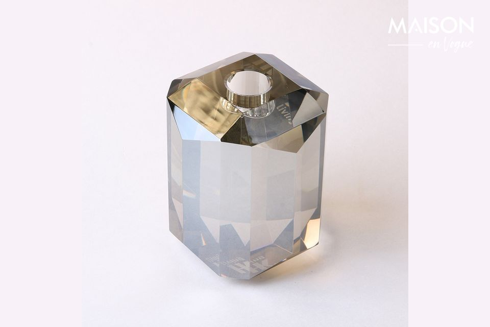 Hand-made, it holds a candle and offers a unique luminosity