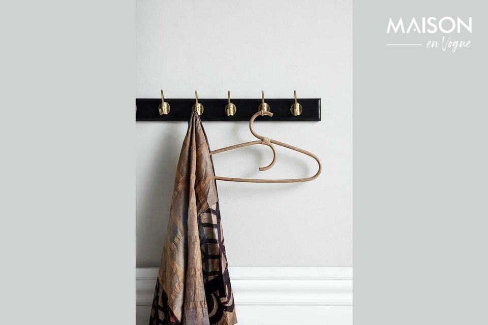 A large coat rack with an elegant design