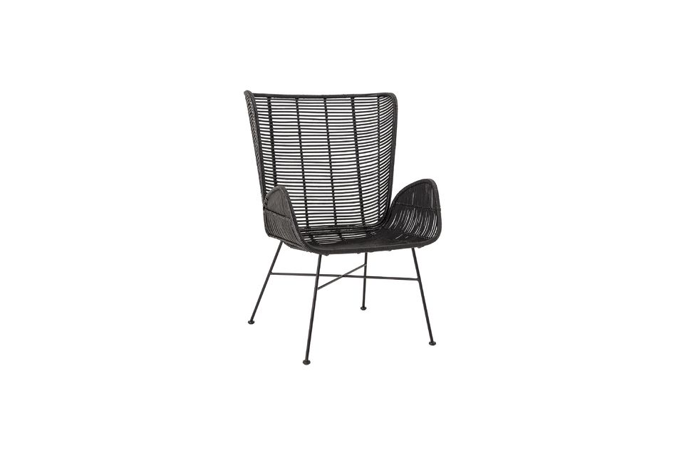 An elegant rattan armchair with a wide backrest
