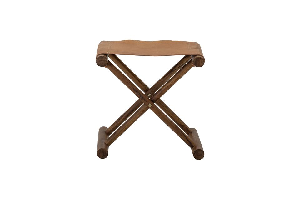 Its crossed legs are made of teak wood varnished in a dark brown stain and the seat is made of