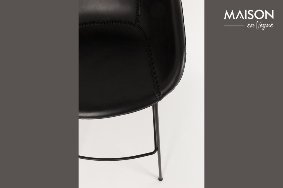 Rising on plastic legs and equipped with a footrest, this counter stool is solid and stable