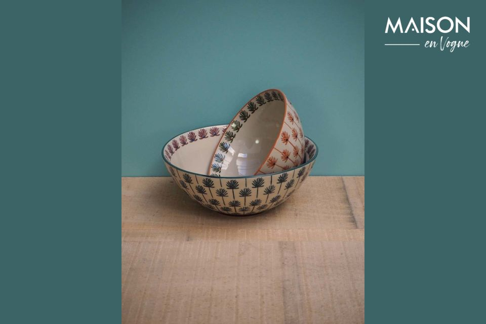 This elegant Flabella bowl, made of ceramic, reveals very fine patterns with a vegetal resonance
