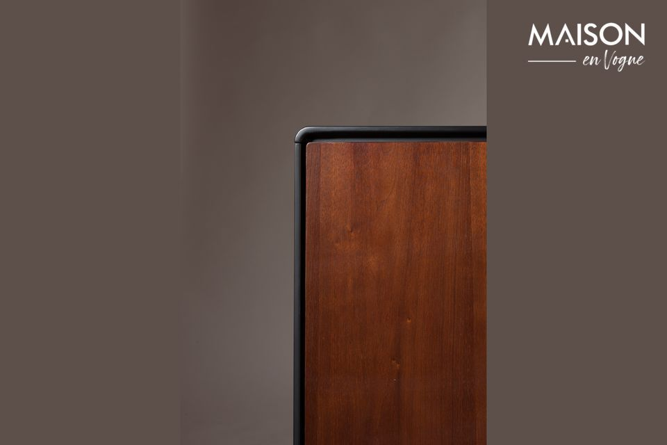 The hazelnut veneer on the doors and drawers as well as the dark wood shades give this piece of