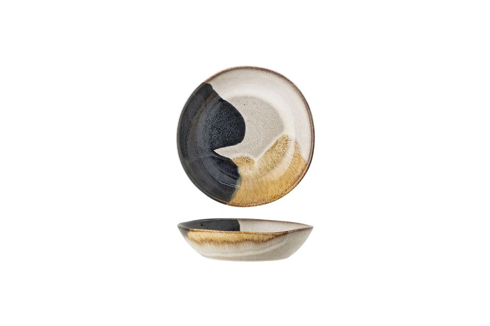 Its hand-crafted stoneware design makes it a unique piece with elegant colour variations