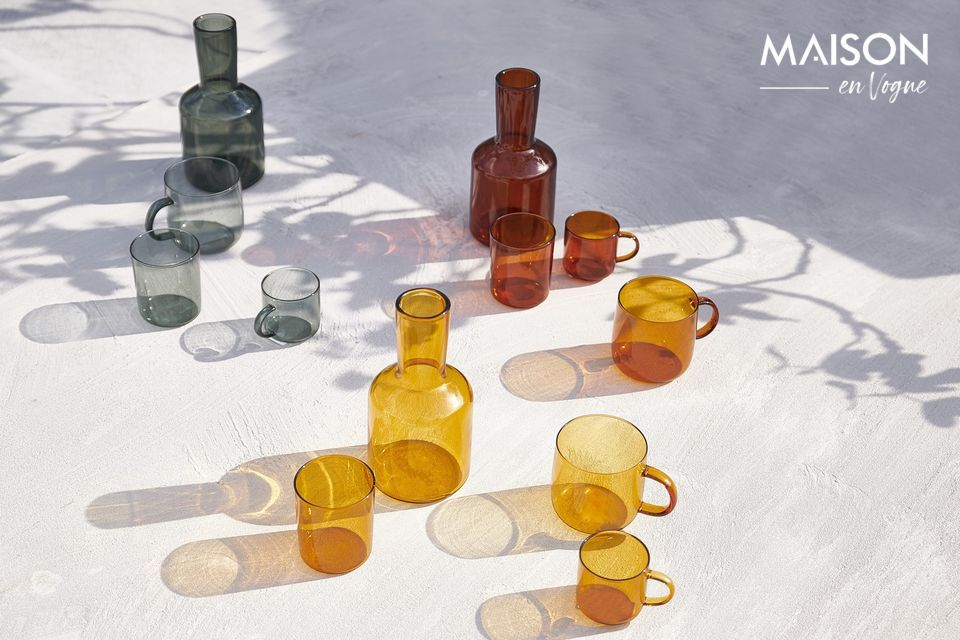 The amber hue of the decanter and the Lasi glass accentuates their refinement