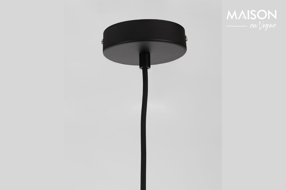 Its black painted concrete lampshade is engraved with the letters of the Zuiver brand