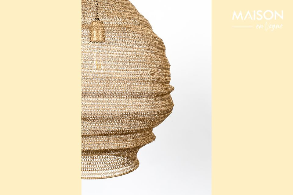This hanging lamp is immediately appealing because of the fine mesh surrounding it