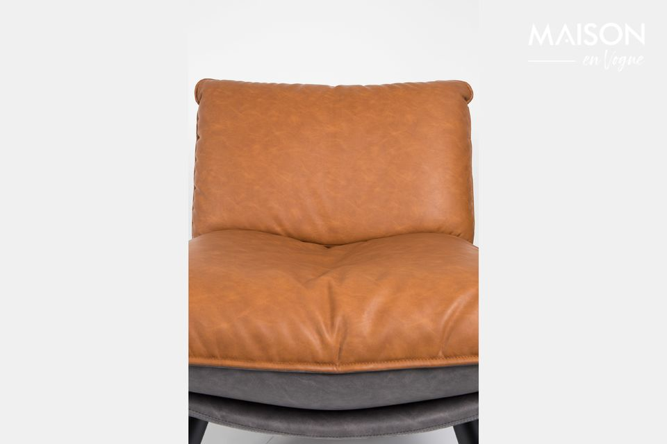 A comfortable chair revealing a vintage design and refined finishes