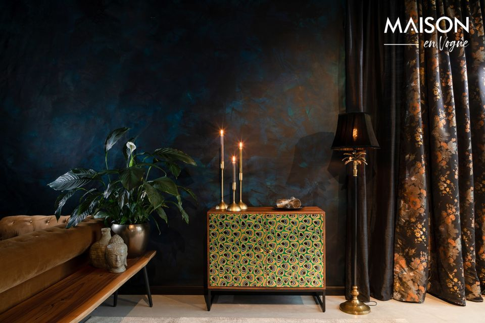 This sideboard is made of mango wood and its brass plated doors are decorated with green
