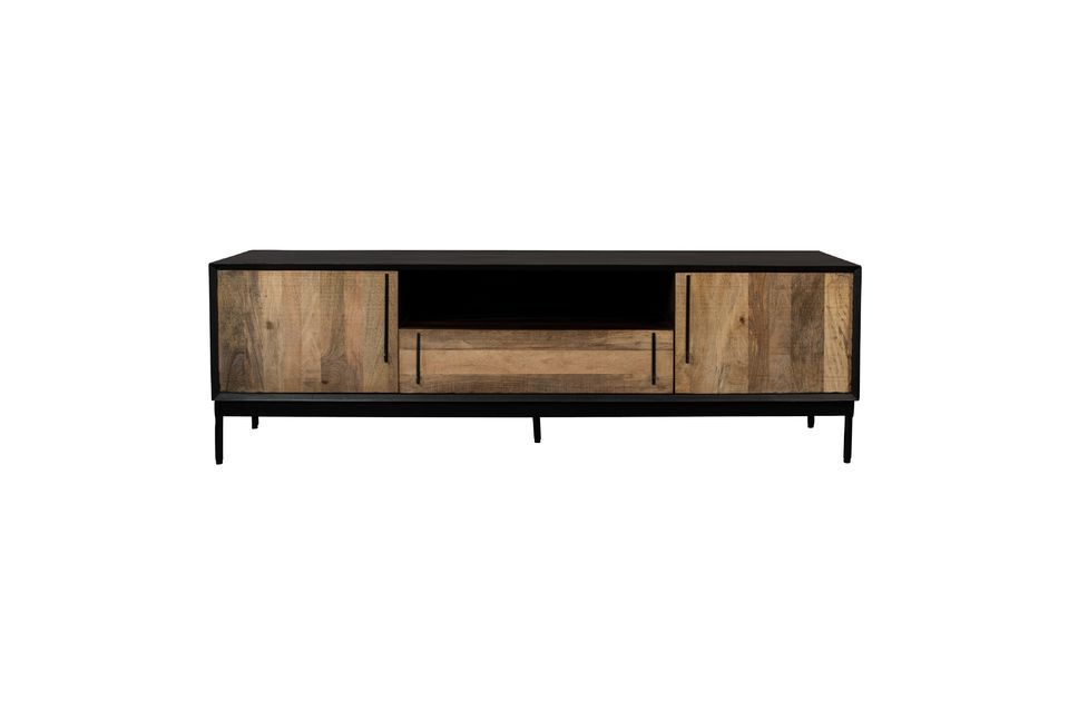 In addition to its two side cupboard doors, it has a central drawer and above it a shelf
