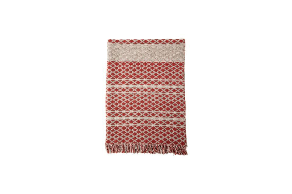 Its red and cream patterns are continued with a fringed finish