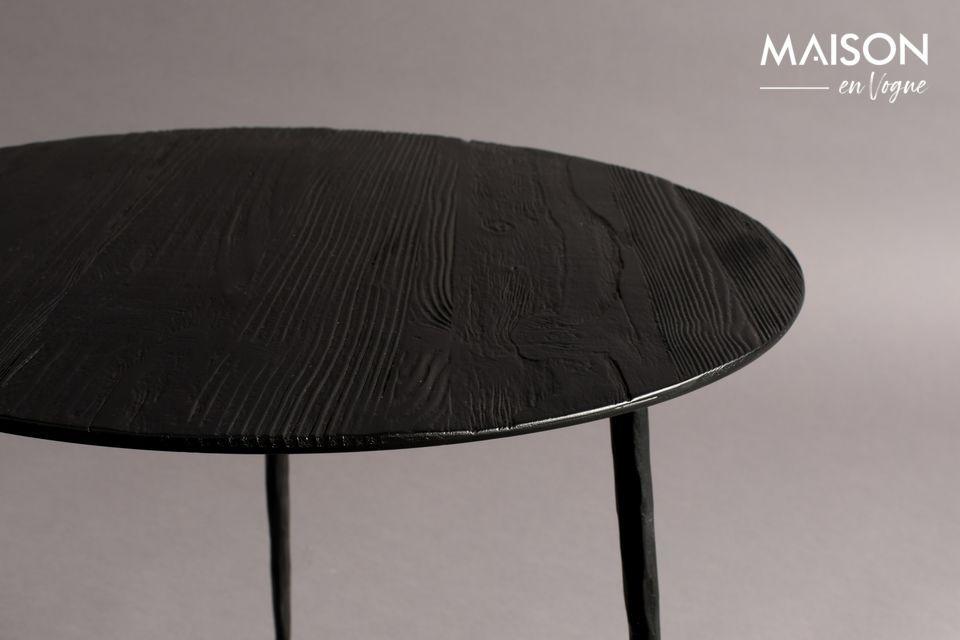 Its circular lacquered steel top has a fine pine or oak veneer