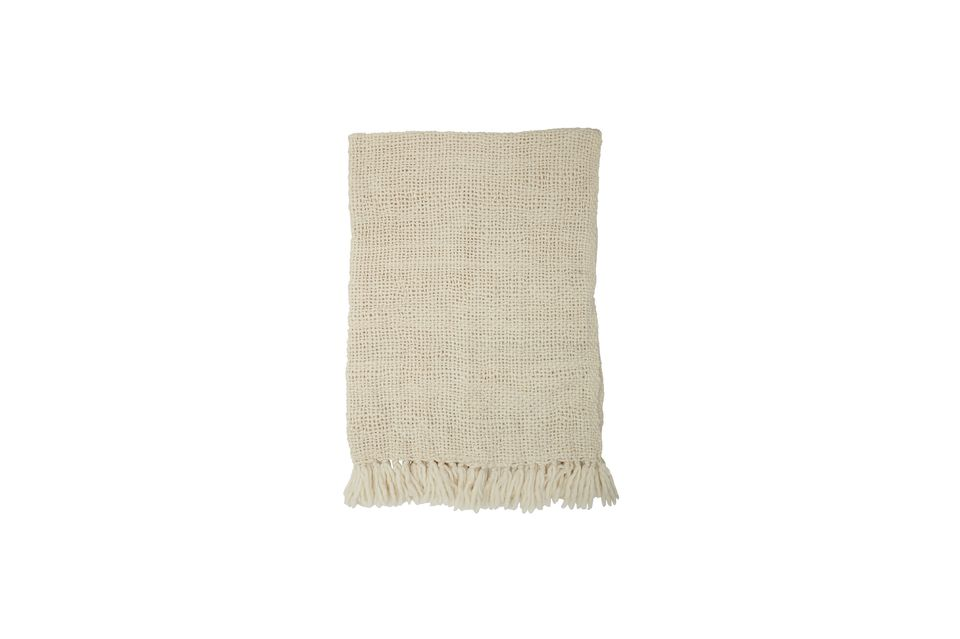 Its soft and warm material woven in a very graphic spirit attracts by its suppleness