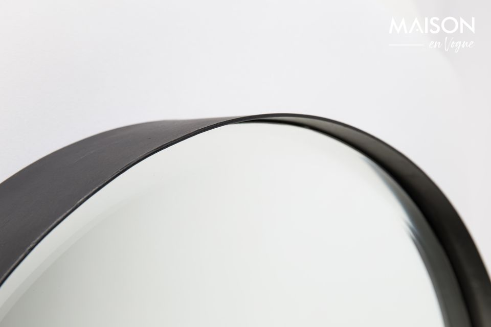 A modern circular faceted mirror