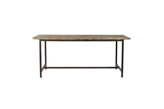 Rough dining table in wood and metal