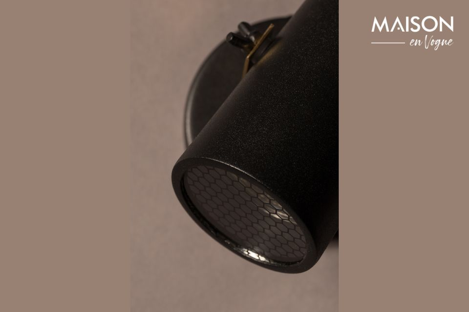 With its black lacquered steel shade and brass bracket