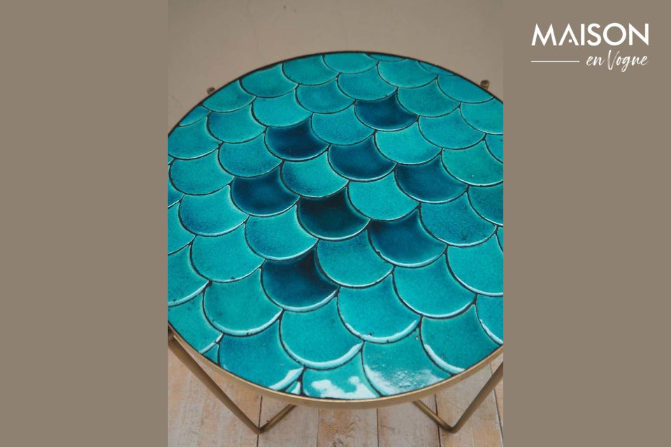 The Séguret side table offers an unusual architecture with its blue scales designed in ceramic