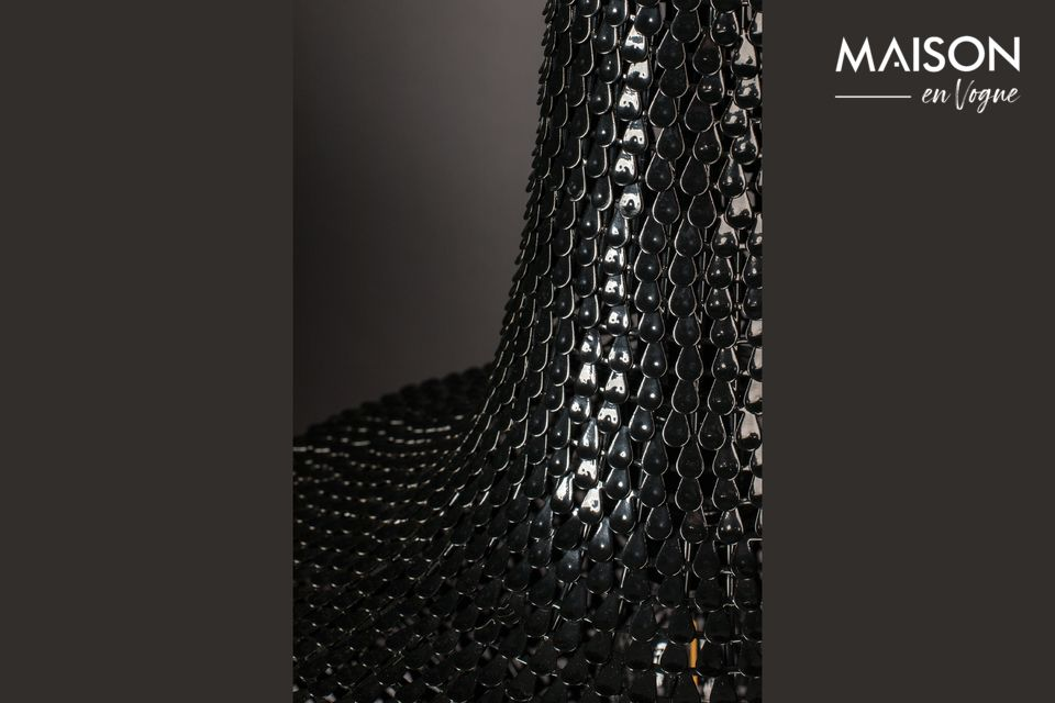 It is made of hundreds of thin strips of iron laid by hand, like fish scales