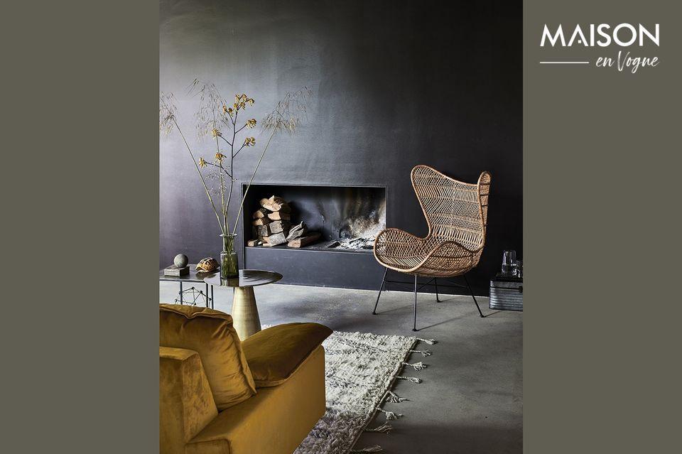 It is a two-seater sofa in ochre velvet