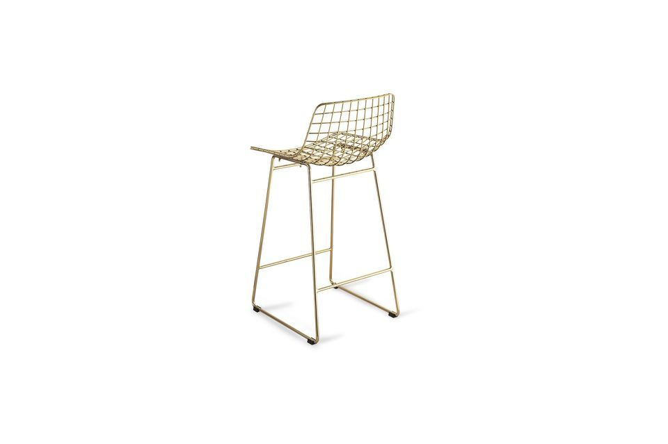 This bar stool is designed in gold brass for a light and clean style